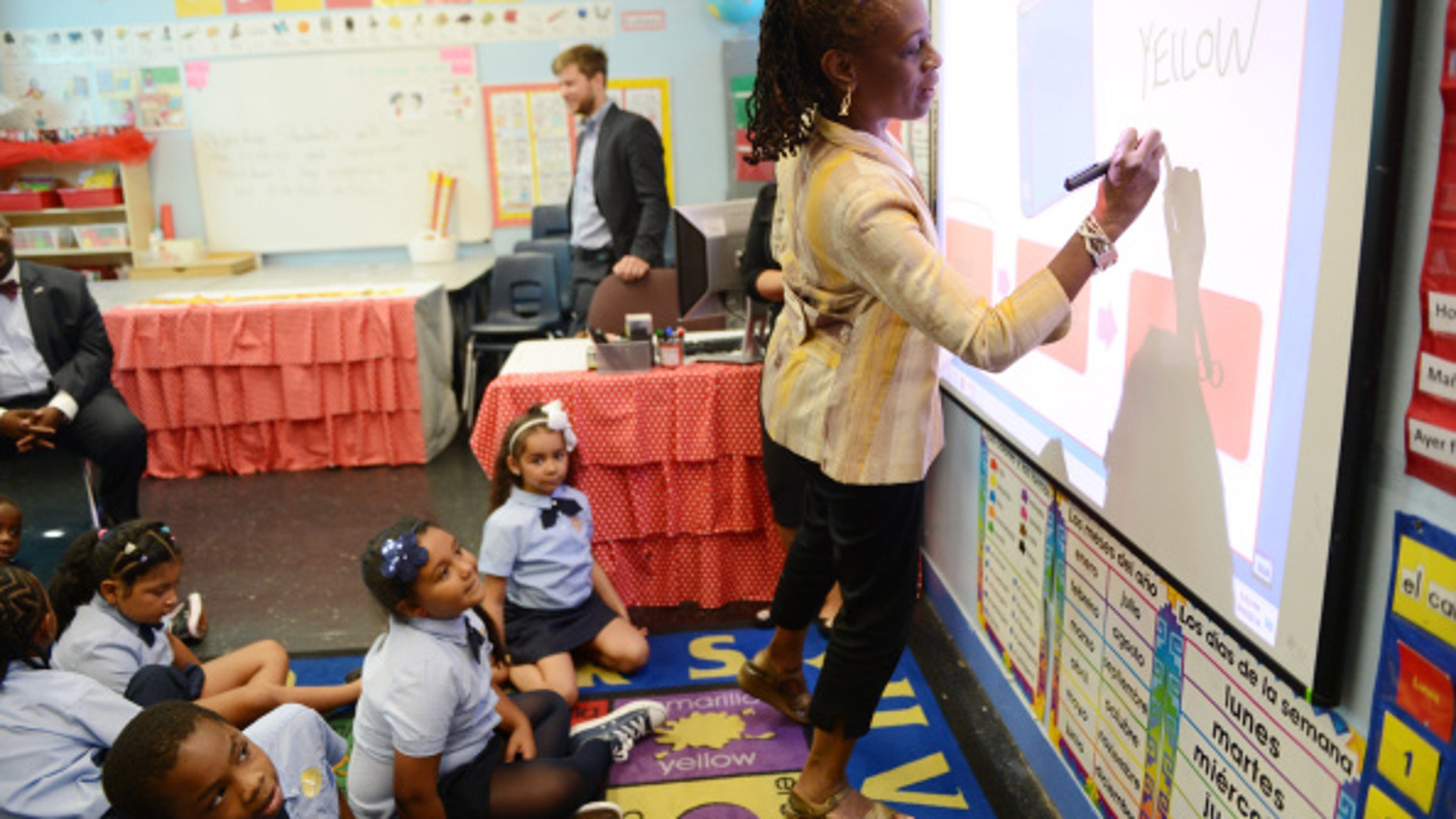 NEW YORK, NY - SEPTEMBER 4:   First Lady Chirlane McCray plays a color naming game with students in a second grade Spanish class at Amber Charter School in Manhattan on the first day of NYC public schools, September 4, 2014 in New York City. New York Mayor Bill de Blasio is touring universal pre-kindergarten programs throughout the city. (Photo by Susan Watts-Pool/Getty Images)