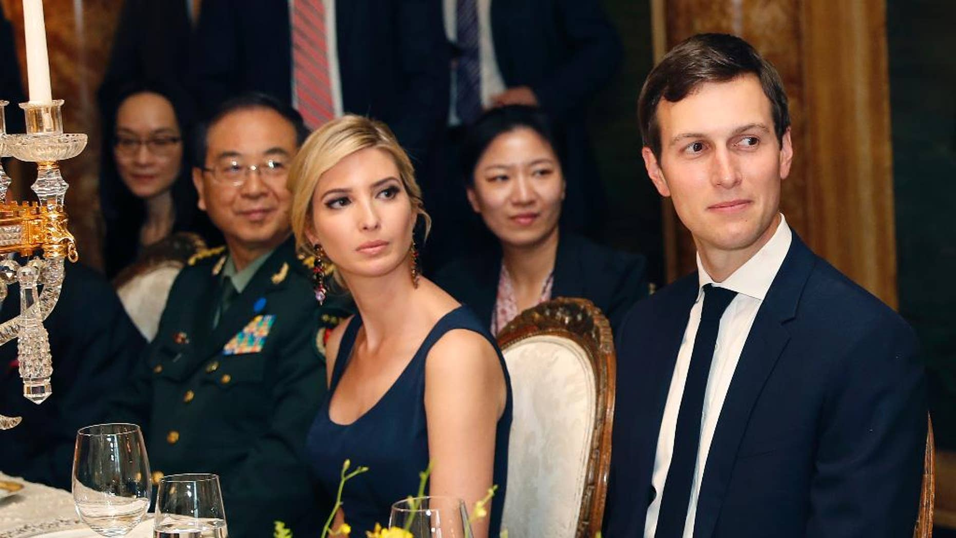 FILE - In this Thursday, April 6, 2017, file photo, Ivanka Trump, second from right, the daughter and assistant to President Donald Trump, is seated with her husband White House senior adviser Jared Kushner, right, during a dinner with President Donald Trump and Chinese President Xi Jinping, at Mar-a-Lago, in Palm Beach, Fla. China's Ministry of Foreign Affairs spokesman Lu Kang on Wednesday defended the handling of the applications of the trademarks won by U.S. President Donald Trump's daughter Ivanka and her company, saying that all such requests are handled fairly. (AP Photo/Alex Brandon, File)