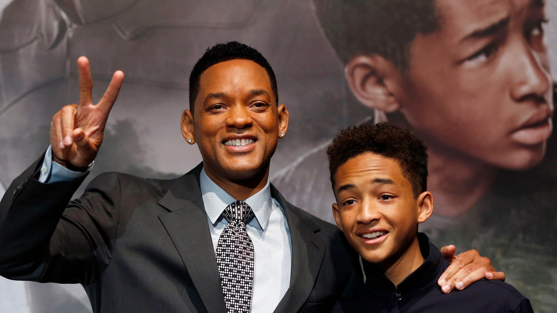 "Will Smith, left, and his son Jaden Smith arrive a news conference to promote their movie ""After Earth"" in Tokyo May 2, 2013."