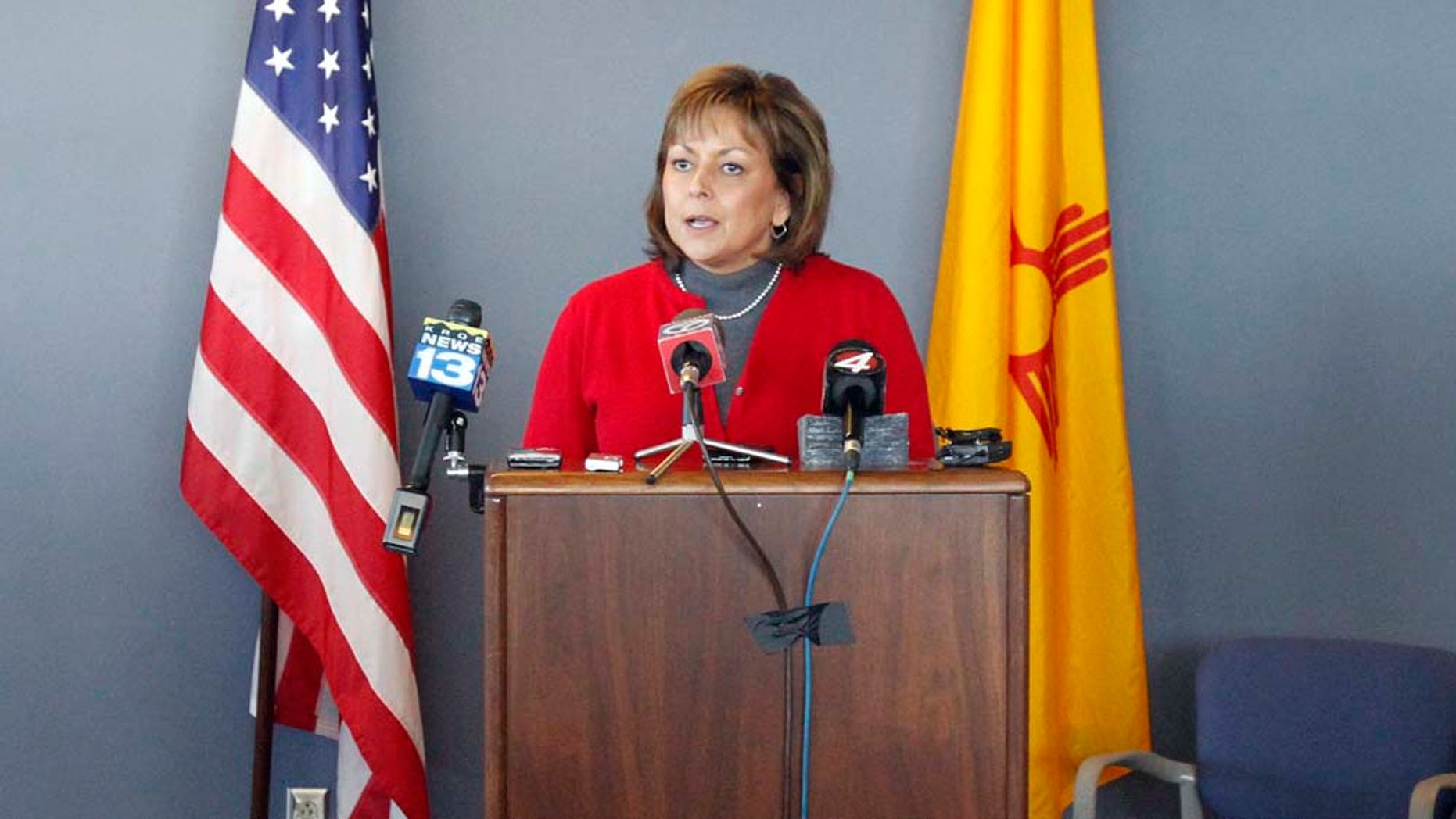 New Mexican Governor Susana Martinez makes announcements regarding gas shortages from the Emergency Operating Center on the National Guard Base just south of Santa Fe, N.M., on Thursday, Feb. 3, 2011.  Secretary of Homeland Security and Emergency Management Michael Duvall, left, and  Major General Kenny C. Montoya, right, look on.    Martinez has declared a state of emergency as thousands of New Mexico residents lost natural gas service due to the bitter cold.  Martinez sent all nonessential state workers home for the day Thursday, and urged all residents to turn down their thermostats, bundle up and shut off appliances they don't need for the next 24 hours.   (AP Photo/The New Mexican, Natalie Guillén)