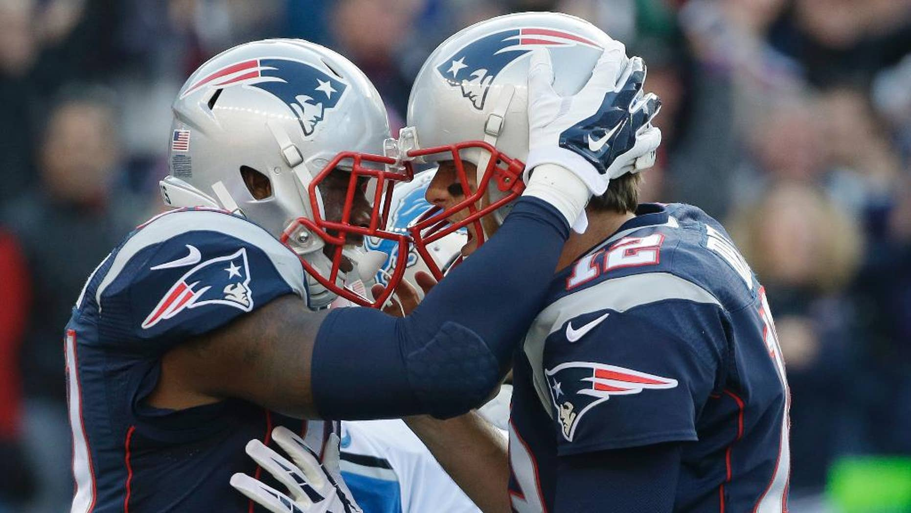 New England Patriots tight end Timothy Wright, left, celebrates after catching his second touchdown pass from Tom Brady, right, in the first half of an NFL football game against the Detroit Lions, Sunday, Nov. 23, 2014, in Foxborough, Mass. (AP Photo/Steven Senne)