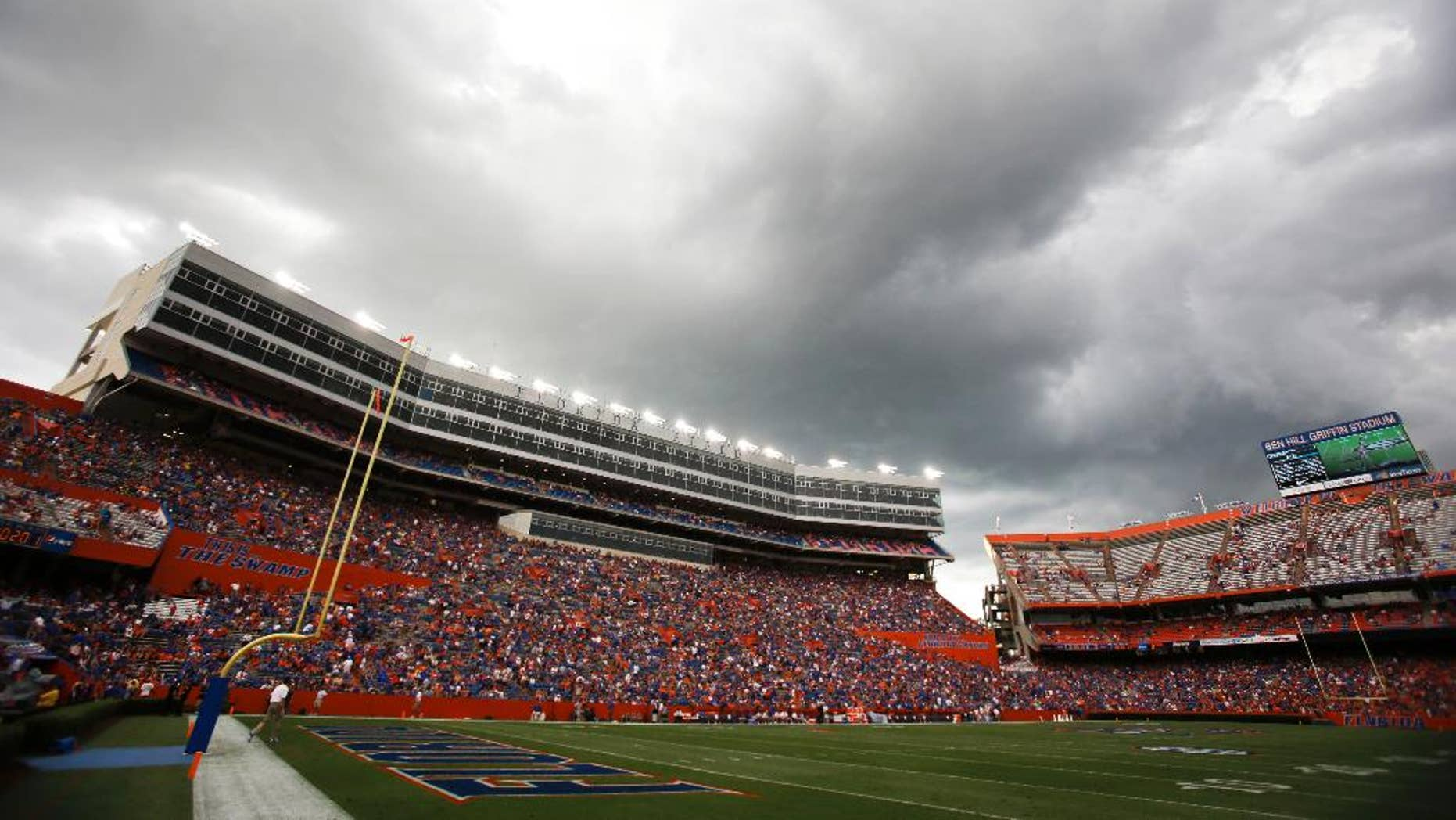 Dark clouds move over Ben Hill Griifin Stadium at Florida Field during a weather delay before the start of an NCAA college football game between Florida and Idaho in Gainesville, Fla., Saturday, Aug. 30, 2014. (AP Photo/John Raoux)