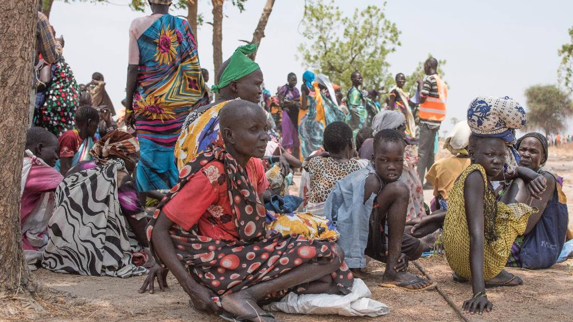 In this photo taken Tuesday, April 11, 2017, Women wait to receive food by ICRC at a site in Leer County region of South Sudan. Two months after a famine was declared in two counties amid its civil war, hunger has become more widespread than expected, aid workers say, region on the brink of starvation and people at risk of dying without sustained food assistance. (AP Photo)
