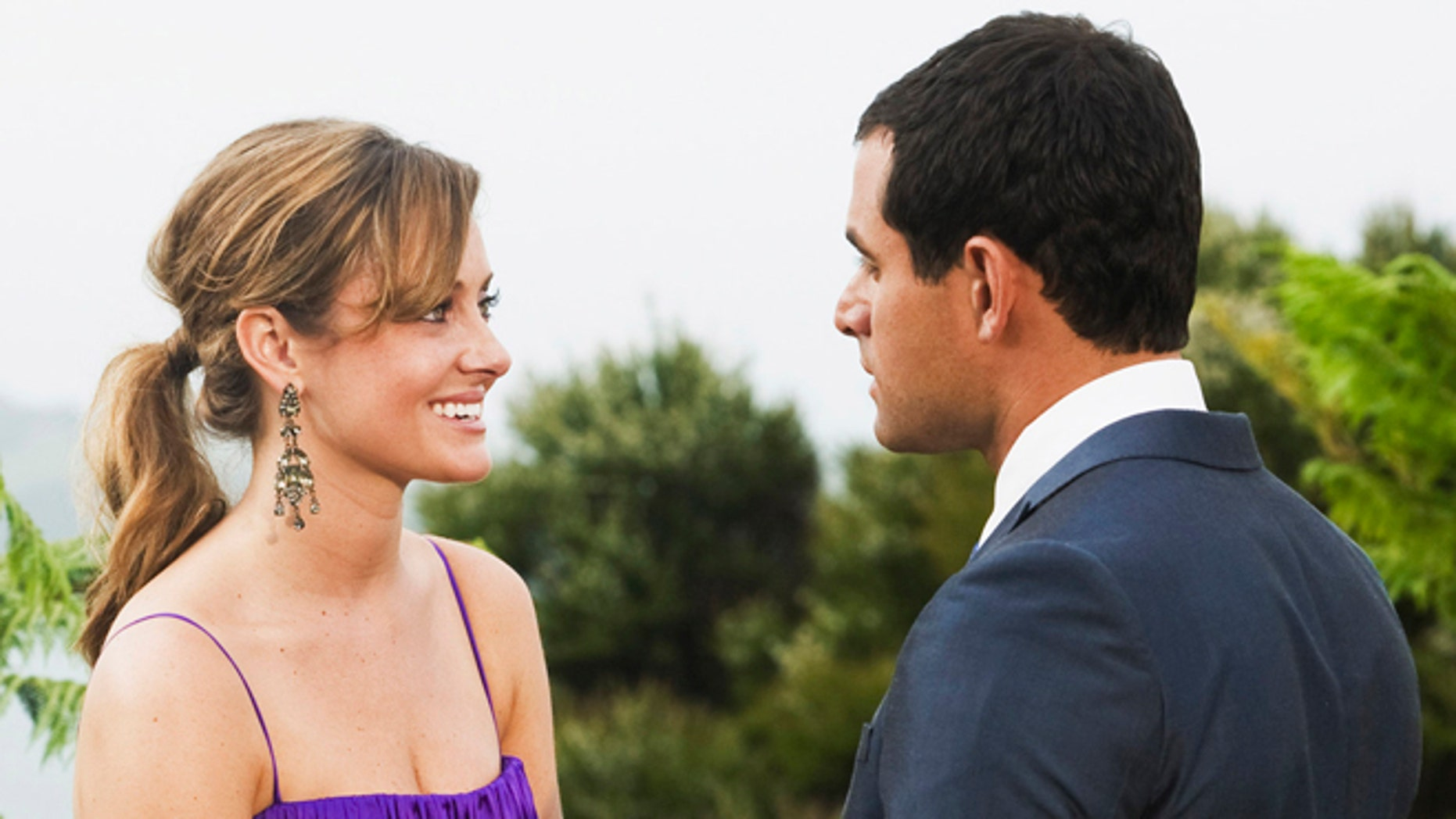 """In this file image originally released by ABC, Jason Mesnick, right, is shown with Molly Malaney on the season finale of """"The Bachelor,"""" airing Monday, March 2, 2009 on ABC."""
