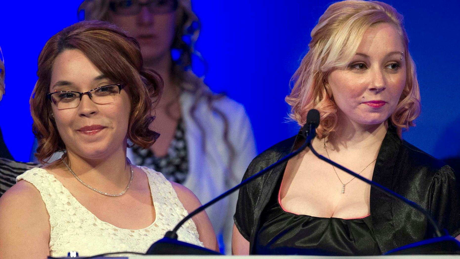 Kidnapping survivors Gina DeJesus, left, and Amanda Berry are honored at the annual National Center for Missing and Exploited Children's Hope Awards dinner in Washington. For years, the two women and a third, Michelle Knight, were held captive in a Cleveland home by Ariel Castro before finally escaping in 2013.