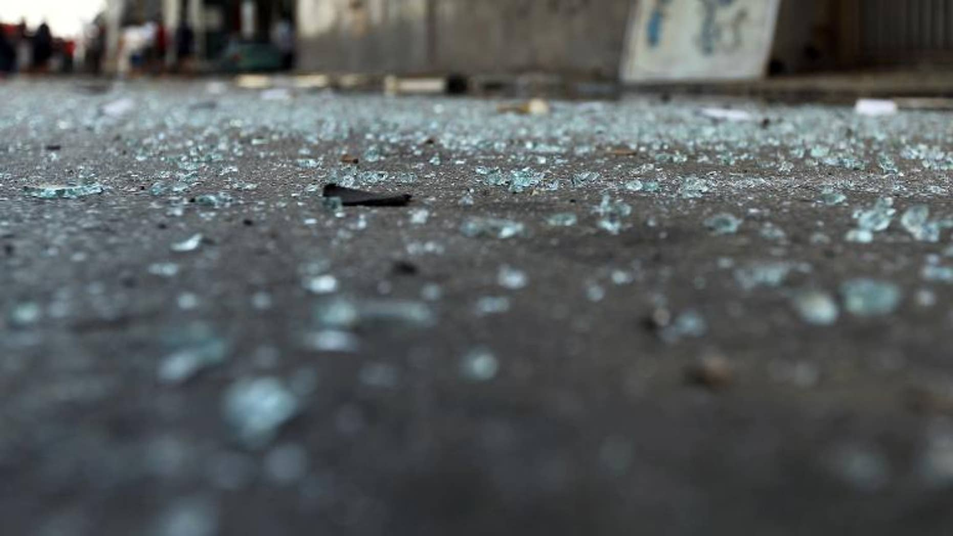 Glass pieces on the ground outside a foreign ministry building that was damaged by a powerful blast on September 11, 2013 in Benghazi.