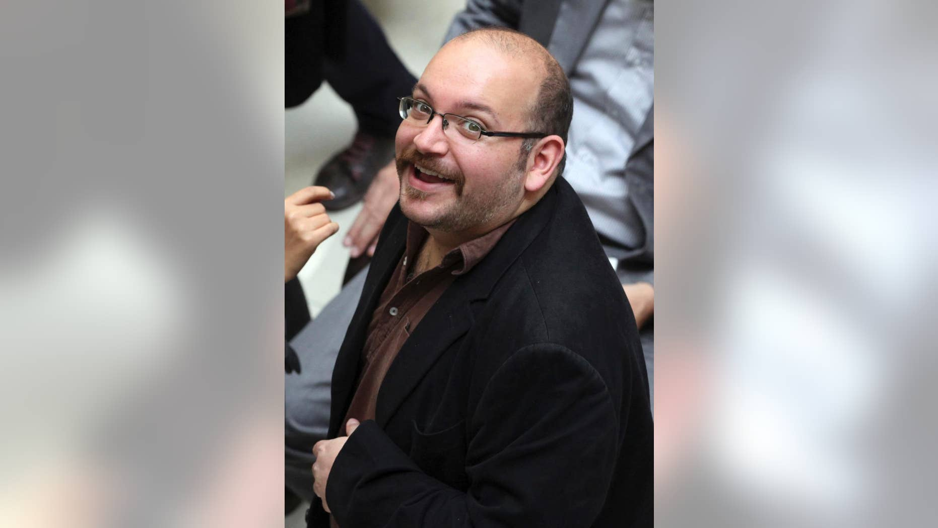 FILE - In this April 11, 2013 file photo, Jason Rezaian, an Iranian-American correspondent for the Washington Post smiles as he attends a presidential campaign of President Hassan Rouhani in Tehran, Iran.  The trial of a Washington Post reporter detained in Iran for nearly 10 months will begin next week, a defense lawyer representing the Iranian-American journalist said Tuesday, May 19, 2015.  (AP Photo/Vahid Salemi, File)