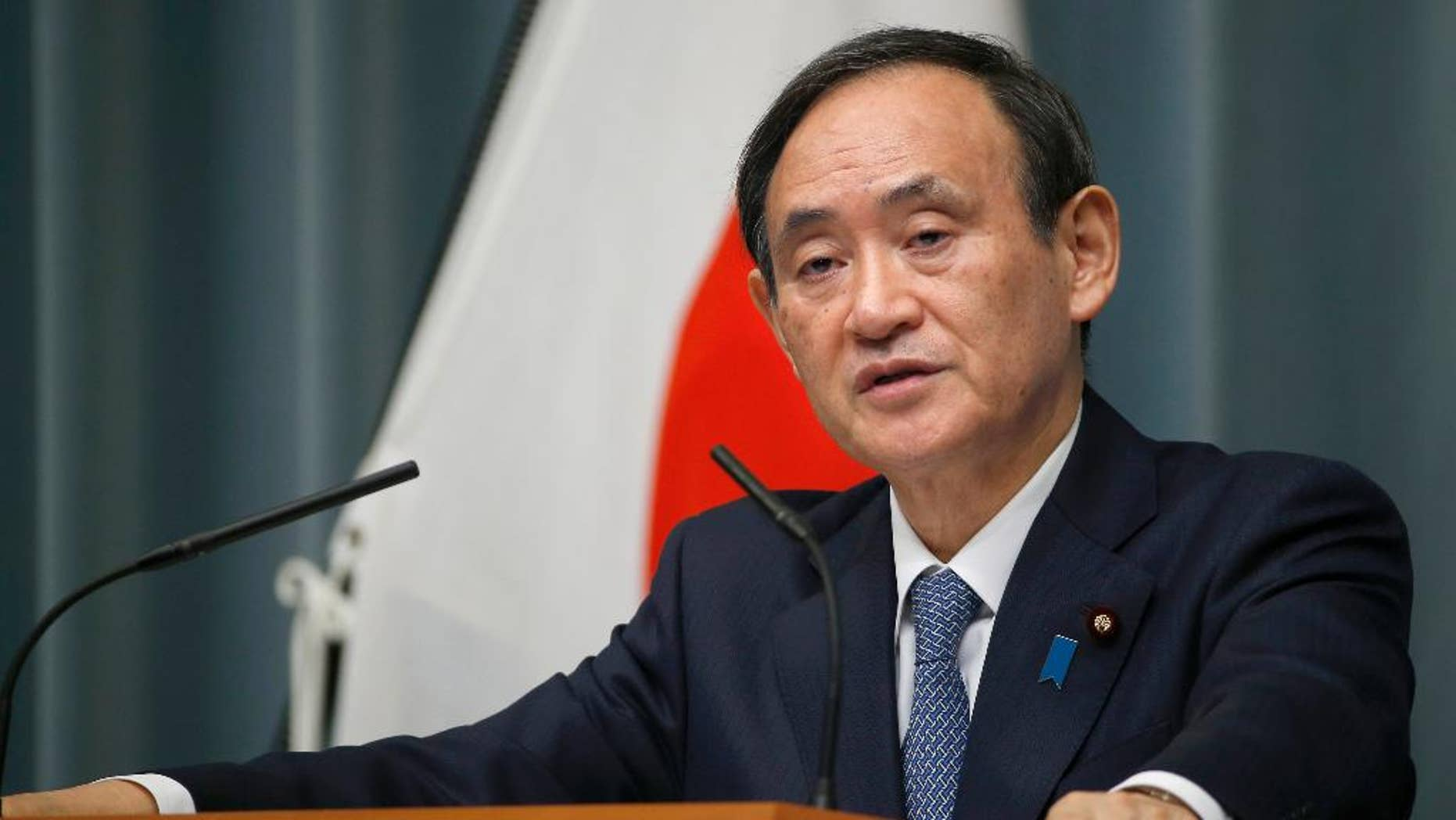 """FILE - In this Feb. 10, 2016, file photo, Japan's Chief Cabinet Secretary Yoshihide Suga speaks to the media during a press conference at the prime minister's official residence in Tokyo. Japanese government spokesman Suga said Monday, March 28, 2016, that Japan would stand by its non-nuclear weapons stance, after U.S. presidential candidate Donald Trump said he would be open to Japan and South Korea having nuclear weapons. Suga told reporters Monday that """"the three principles of not owning, making or allowing nuclear weapons remain important government basic policy."""" (AP Photo/Shizuo Kambayashi, File)"""