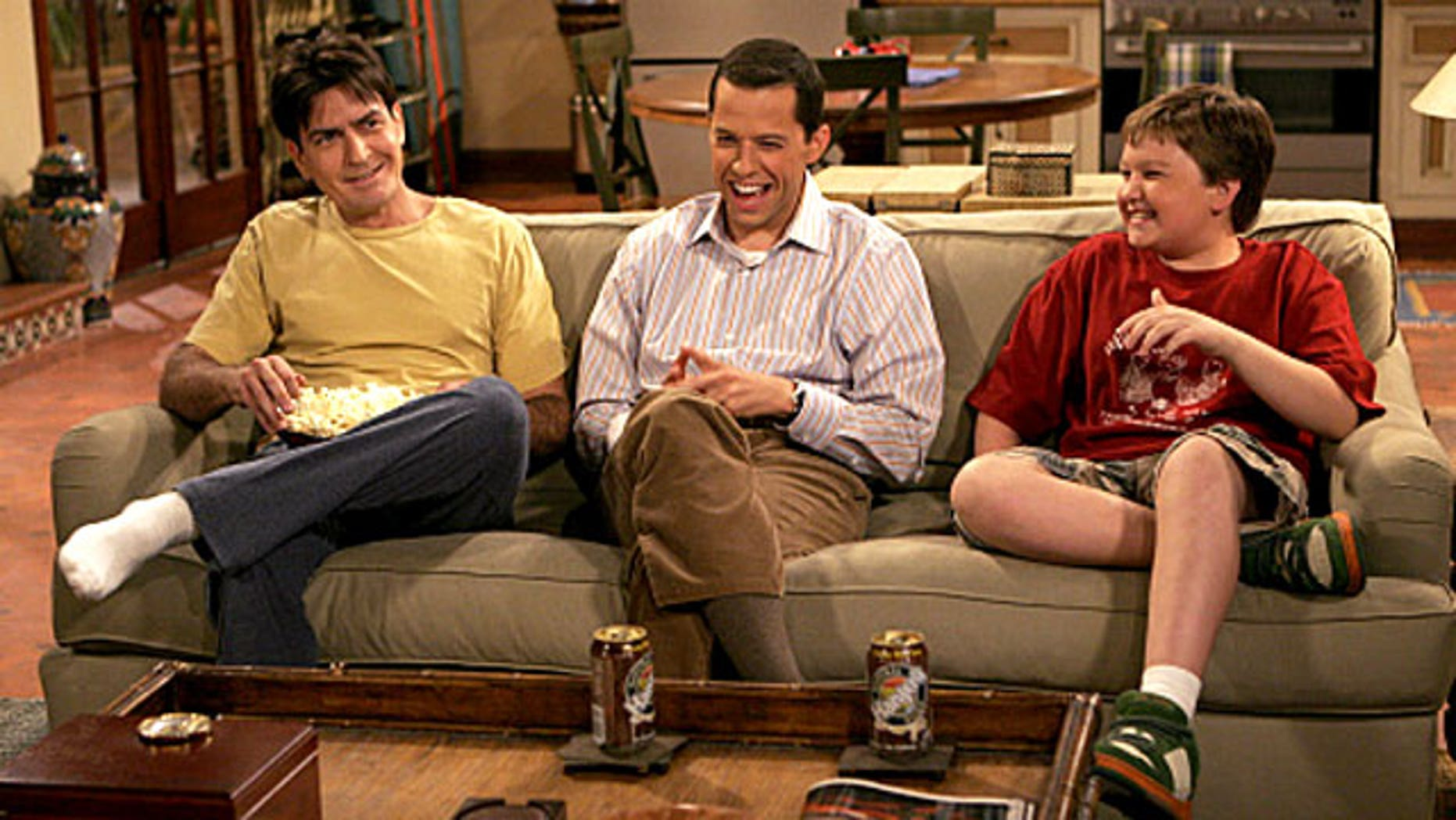 """Charlie Sheen and his """"Two and a Half Men"""" co-stars."""