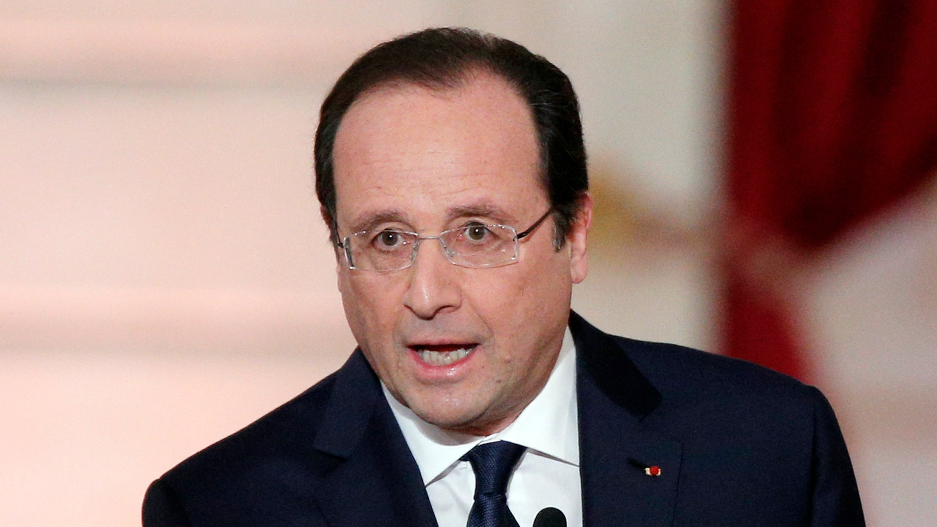 French President Francois Hollande delivers his speech at his  annual news conference, Tuesday, Jan.14, 2014 at the Elysee Palace in Paris. The French president's complex personal life — and what it means to be the first lady in modern society — may get a full airing as Hollande answers questions for the first time since a tabloid reported he was having an affair with an actress. (AP Photo/Christophe Ena)