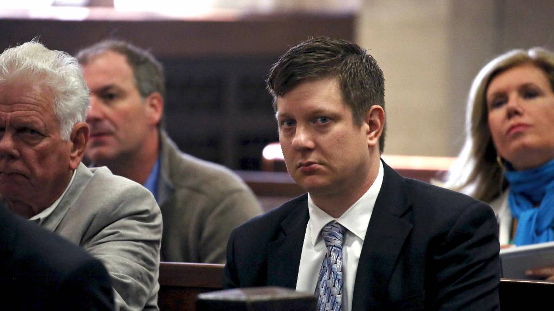 FILE - In this May 5, 2016, file photo, Chicago police officer Jason Van Dyke, charged with first-degree murder in the October 2014 shooting death of a black teenager, sits in court for a hearing in his case in Chicago. Van Dyke's family, with the officer's approval, has spoken out publicly for the first time since he was charged with murder in an interview with the Chicago Tribune. Van Dyke followed his attorney's advice in declining to be interviewed himself. (Nancy Stone/Chicago Tribune via AP, Pool, File)