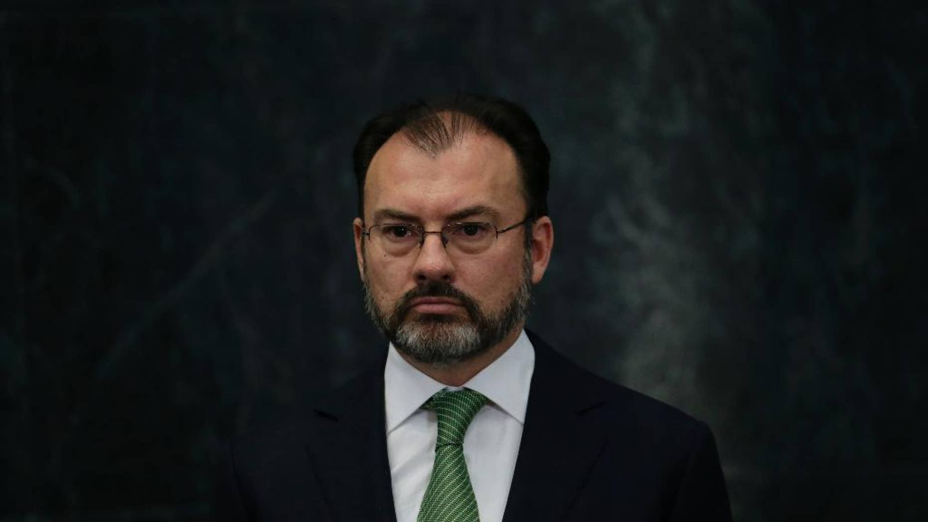 Mexico's new Foreign Relations Secretary Luis Videgaray stands during a press conference at the Los Pinos presidential residence in Mexico City, Wednesday, Jan. 4, 2017. Mexico's president has brought back Videgaray, a close adviser who resigned after arranging a meeting between Pena Nieto and then-presidential candidate Donald J. Trump. (AP Photo/Marco Ugarte)