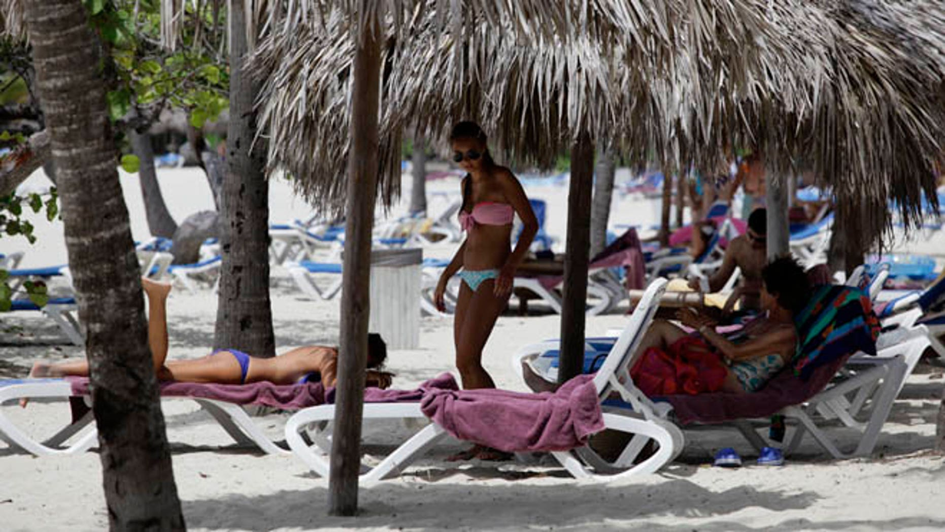 Foreign tourists use the beach at a five-star all-inclusive resort in Varadero, July 29, 2012. Cuba's beaches are an attraction for tourists the world over, whether they are foreigners paying thousands of dollars to reach them, or Cubans paying as little as five dollars for a three-day vacation in a seaside cabin. Picture taken July 29, 2012. REUTERS/Desmond Boylan (CUBA)