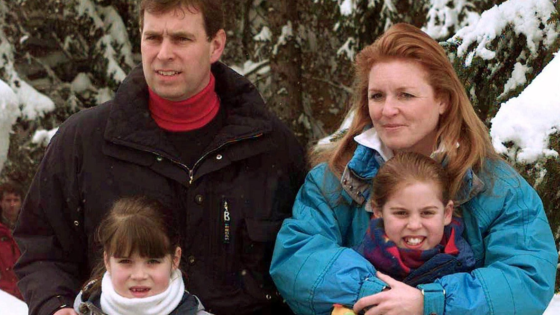 Prince Andrew and his then-wife Sarah Ferguson and their two daughters, Eugenie, bottom left, and Beatrice on February 19, 1999.