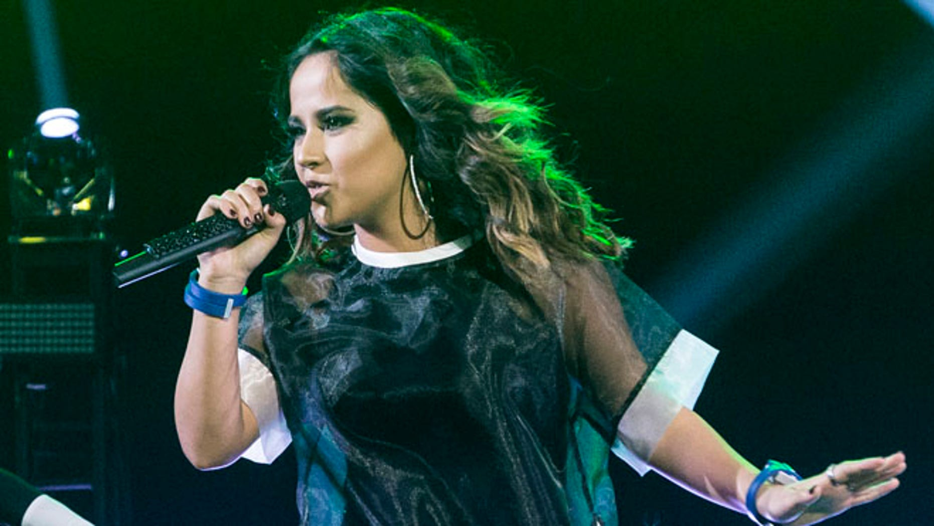 BURBANK, CA - APRIL 18:  Becky G performs on stage at iHeartRadio LIVE Move with the music powered by Degree with Becky G at iHeartRadio Theater on April 18, 2016 in Burbank, California.  (Photo by Rich Polk/Getty Images for iHeartMedia)