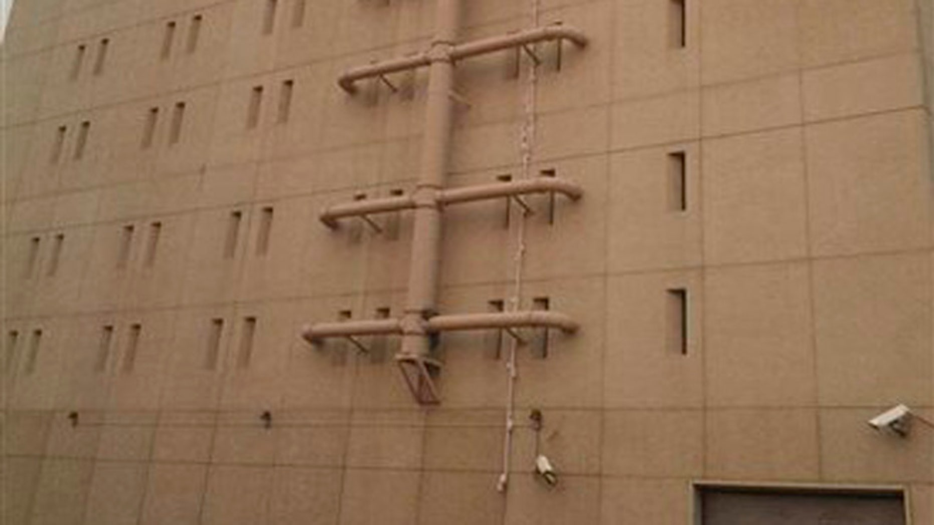 Aug. 20, 2015: In this image made from video taken, bed sheets used in an apparent escape attempt are seen hanging from a top floor window of the Spokane County Jail reaching all the way to the ground in Spokane, Wash.