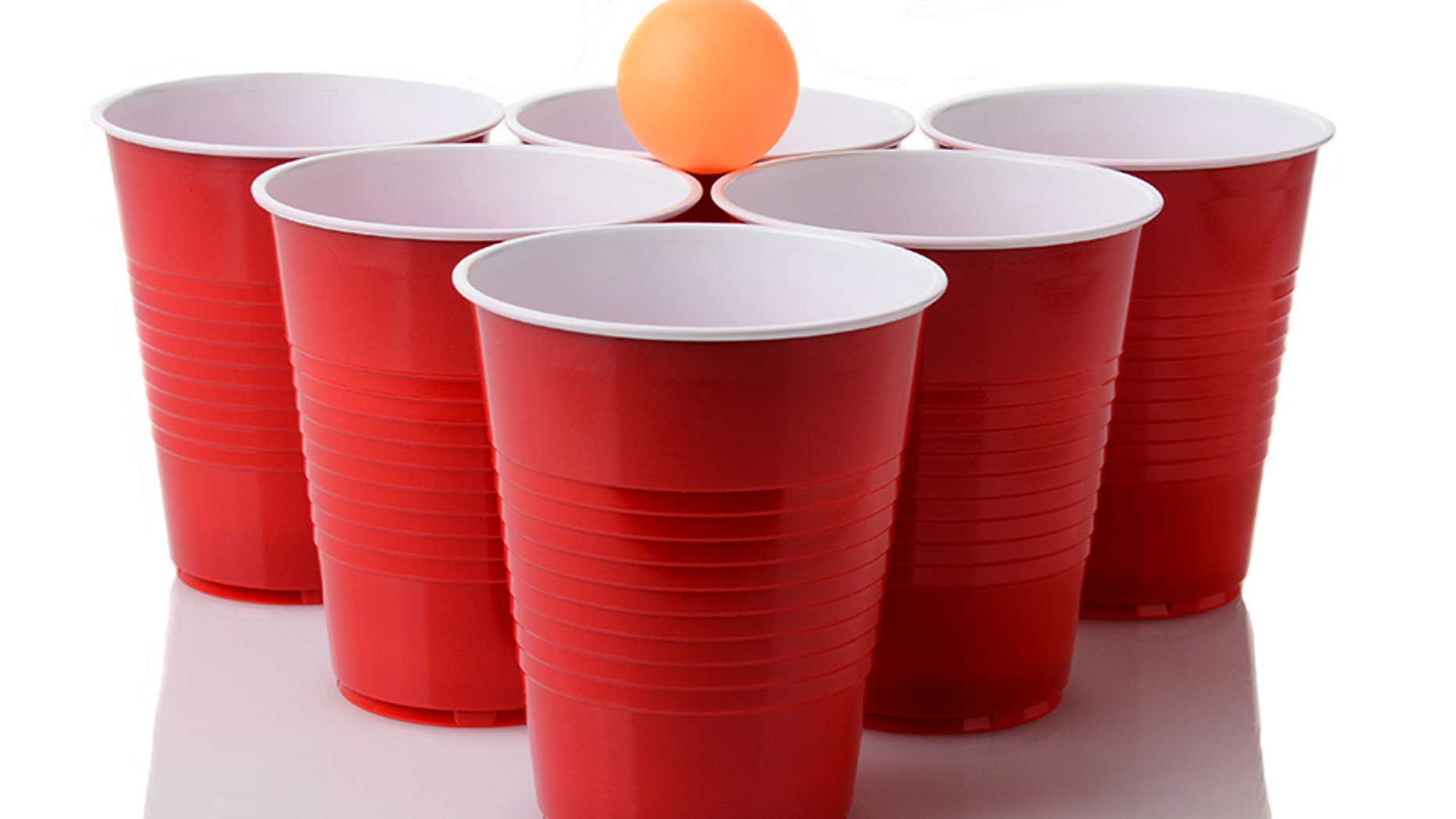 The family of a Connecticut man who died in 2013 after falling out of a window following a game of beer pong, like these people are playing here, was awarded $15.6 million.