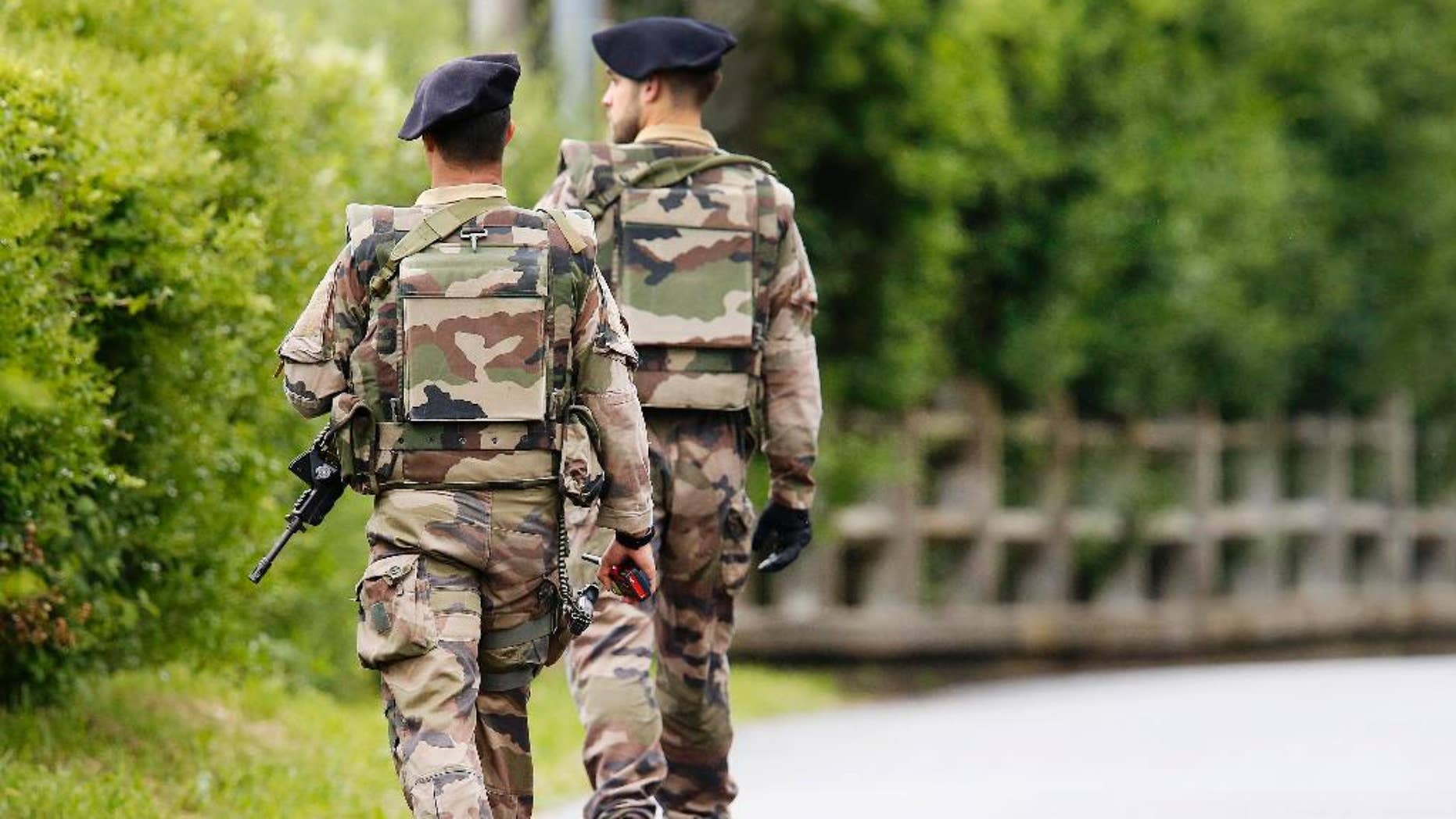 French soldiers patrol near the Camille Fournier stadium at their base camp in Evian, France, Wednesday, June 8, 2016. Germany will face the Ukraine in a Euro 2016 Group C soccer match in Lille on Sunday, June, 12, 2016. (AP Photo/Michael Probst)