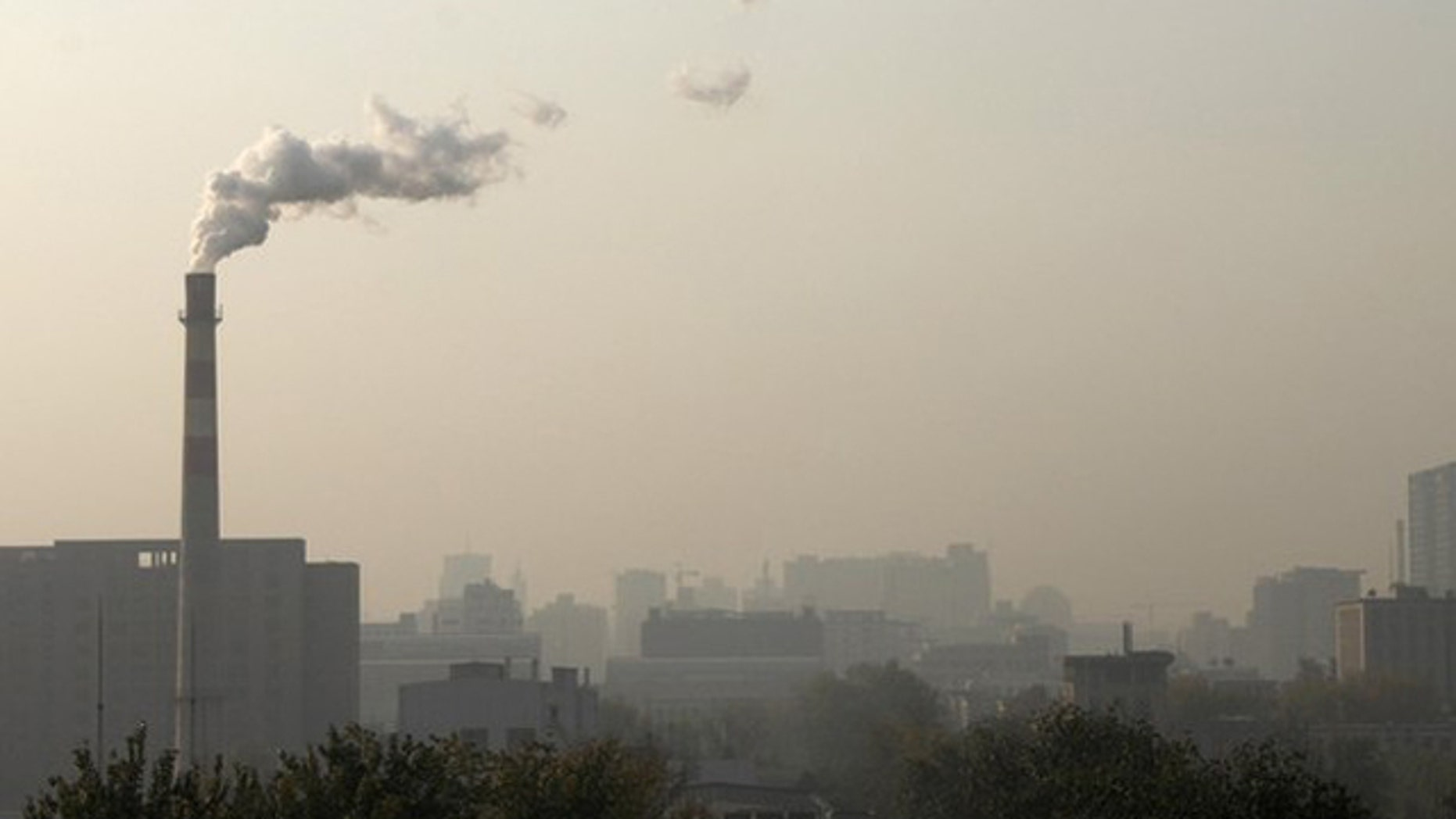 Smoke billows from a chimney of a heating plant in Beijing on Nov. 6, 2010. A new congressional report shows hundreds of EPA grants went overseas to fund environmental projects including an anti-air pollution initiative in China.