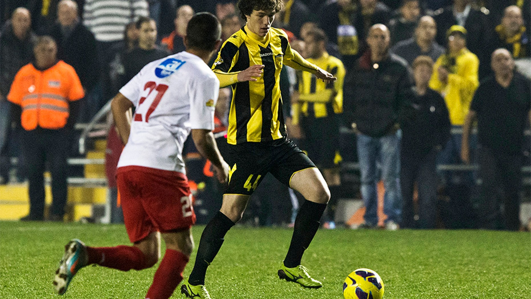 Feb. 10, 2013: Beitar Jerusalem's Dzhabrail Kadiyev, right, plays during a match against Bnei Sakhnin as part of the Israeli Premier League, at Teddy Stadium in Jerusalem.