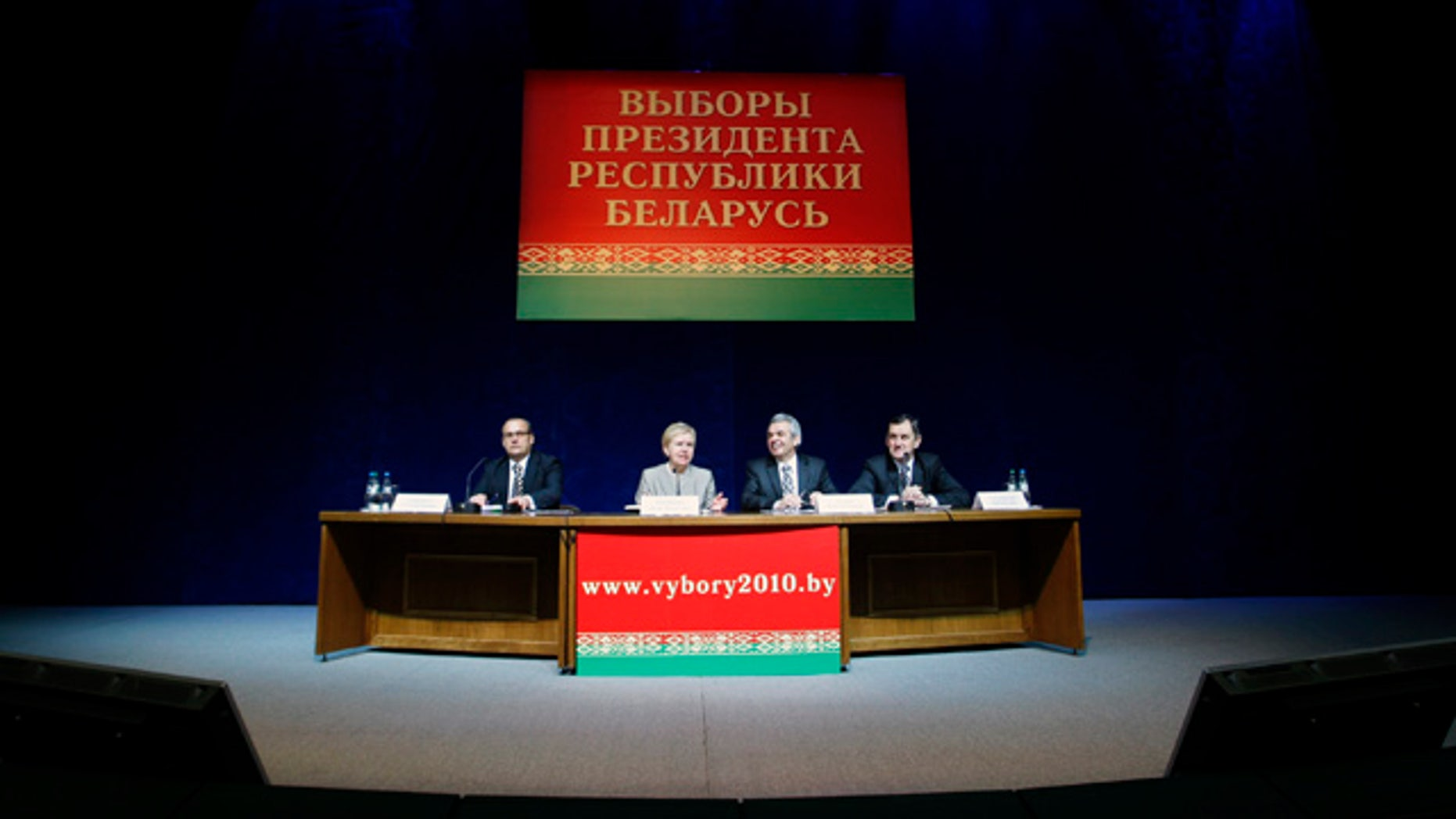 Dec. 20: Central Elections Commission Chairwoman Lidiya Ermoshina, second from left, speaks during a news conference in the Belarusian capital, Minsk. Belarus' President Alexander Lukashenko won a fourth term with nearly 80 percent of the vote, election officials said Monday, hours after truncheon-wielding riot police dispersed thousands of demonstrators who protested alleged vote fraud. (AP)