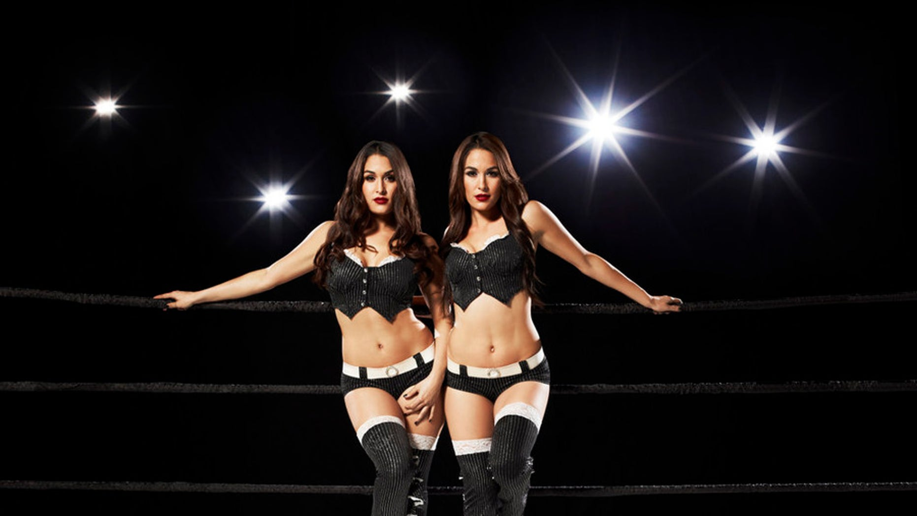 The Bella Twins appear in an E! photoshoot. (Photo by: Timothy White/E!)