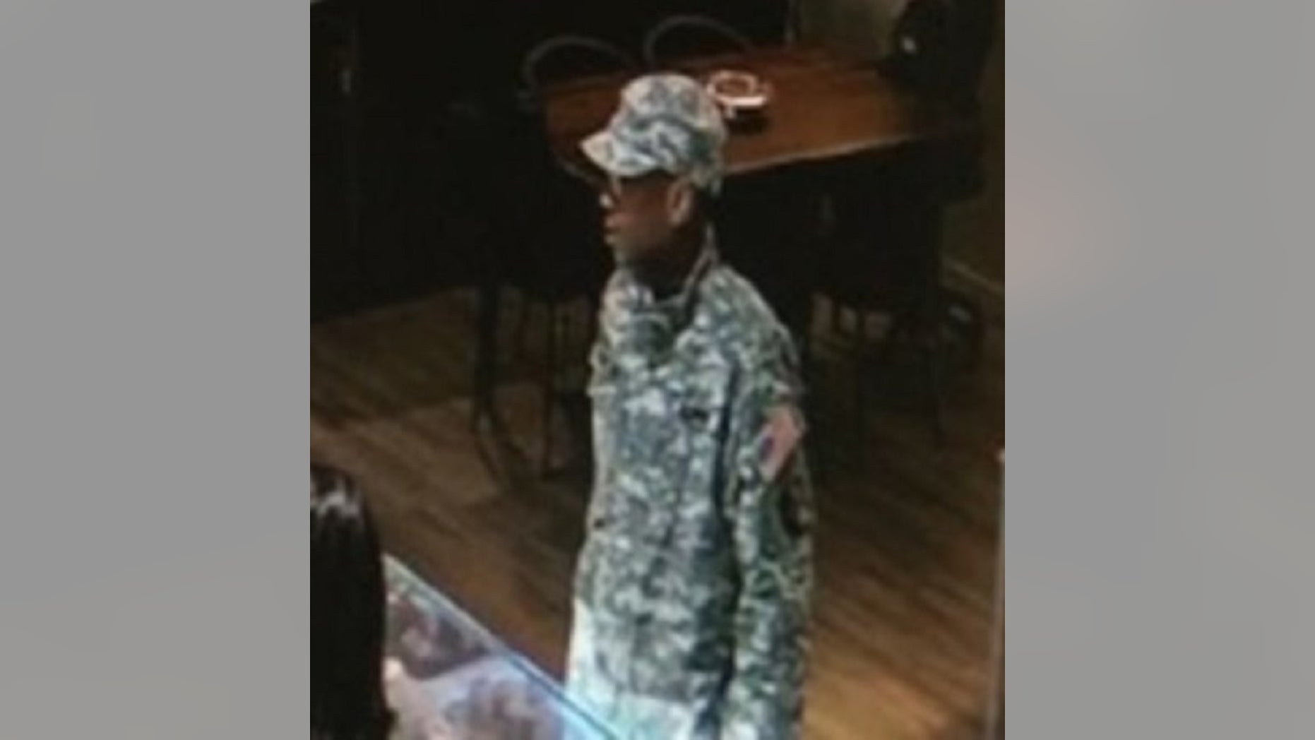 Police released an image of a suspect identified as Arquae Daveon Kennedy, 26. He is accused of impersonating a soldier and stealing a $100,000 marquise diamond on Feb. 22, authorities said Wednesday.