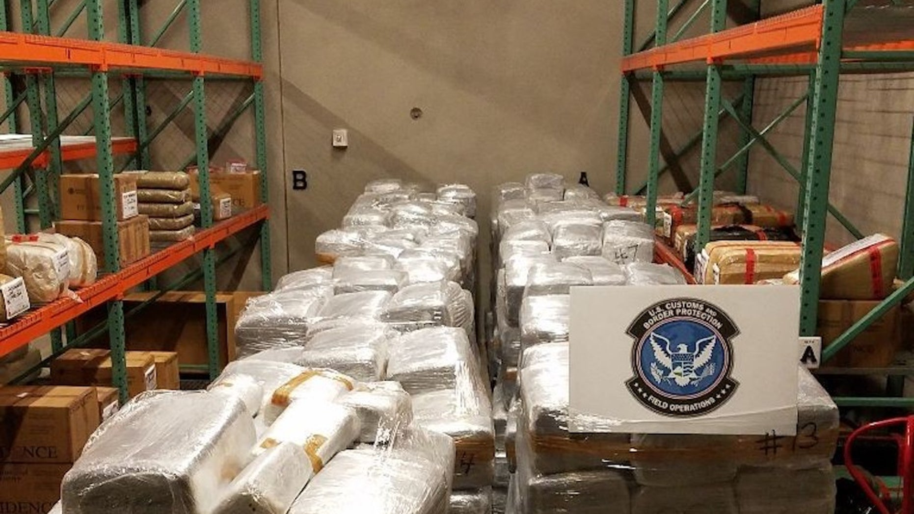 U.S. Customs and Border Protection officers in Nogales, Arizona, seized 13,700 pounds of marijuana, worth more than $6.8 million, that was hidden among bell peppers on a tractor trailer at the Mariposa Commercial Facility on Saturday, May 13, 2017 .