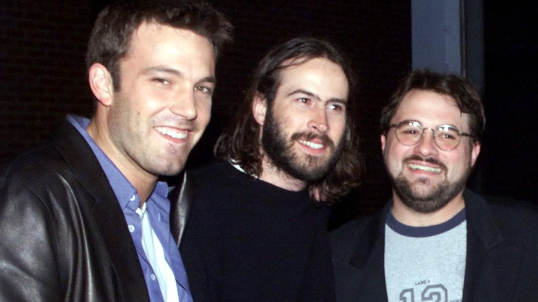 Ben Affleck, Jason Lee, director Kevin Smith pose on Nov. 9, 1999.