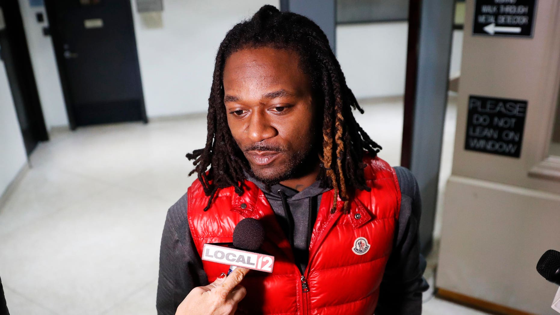 """Bengals cornerback Adam """"Pacman"""" Jones speaks to reporters as he is released from the Hamilton County Justice Center after be charged with felony harassment with a bodily substance, , Wednesday, Jan. 4, 2017, in Cincinnati. He is also charged with assault, disorderly conduct and obstructing police. An attorney representing Jones has told a Hamilton County judge that he """"vehemently denies"""" the charges that led to his arrest. (AP Photo/John Minchillo)"""