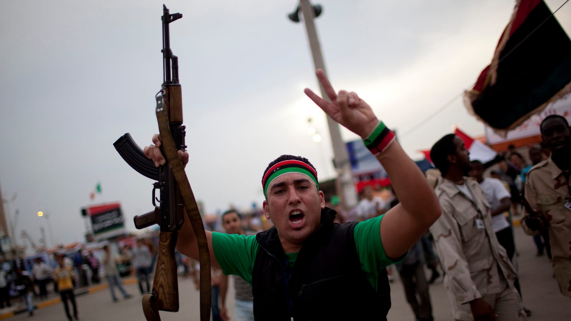 A man chants anti-Muammar Qaddafi slogans during a protest in the rebel strong hold of Benghazi, Libya, Thursday, June 2, 2011. (AP)