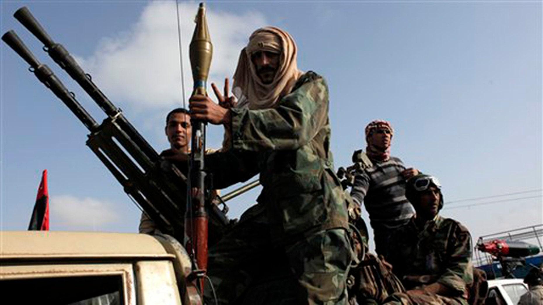 Libyan rebels take part in a military parade in Benghazi, Libya, April 27.