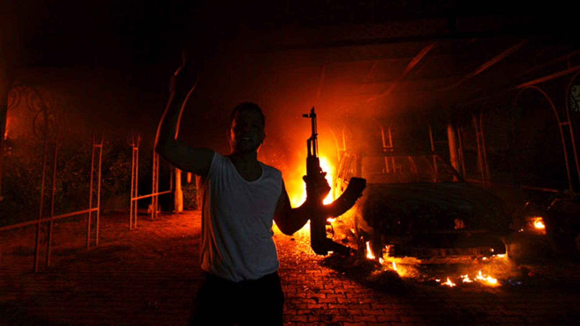 Sept. 11, 2012: A protester reacts as the U.S. Consulate in Benghazi is seen in flames. (Reuters)