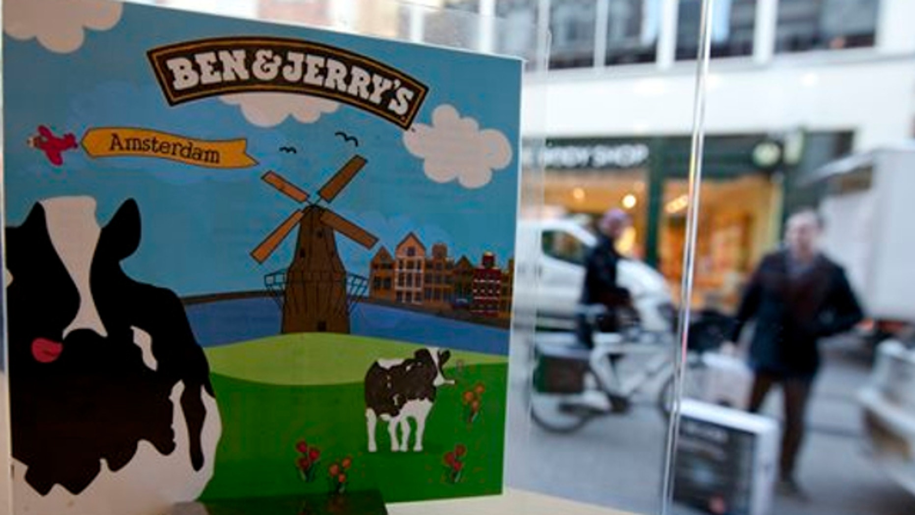 Feb. 2, 2012: People pass a Ben & Jerry's ice cream franchise store in Amsterdam, Netherlands.