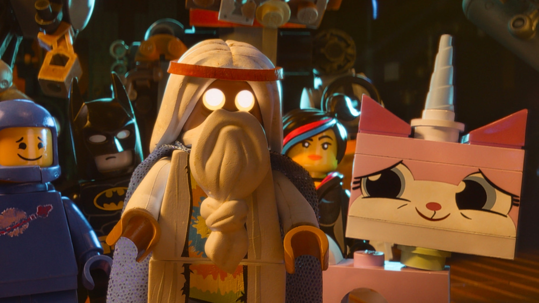 "Benny, voiced by Charlie Day, Batman, voiced by Will Arnett, Vitruvius, voiced by Morgan Freeman, Wyldstyle, voiced by Elizabeth Banks and Unikitty, voiced by Alison Brie, in a scene from ""The Lego Movie."""