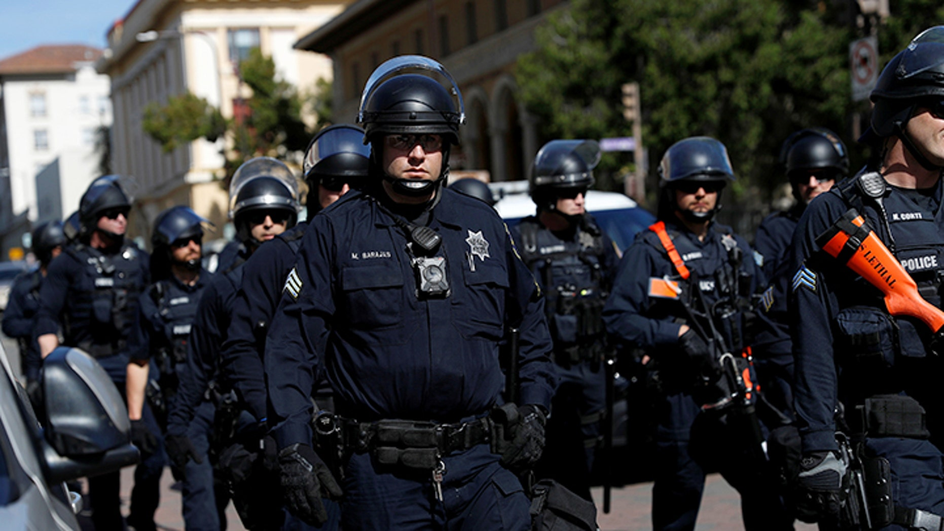 Police in riot gear standing at the ready as opposing factions gather over the cancellation of conservative commentator Ann Coulter's speech at the University of California, Berkeley, last April.
