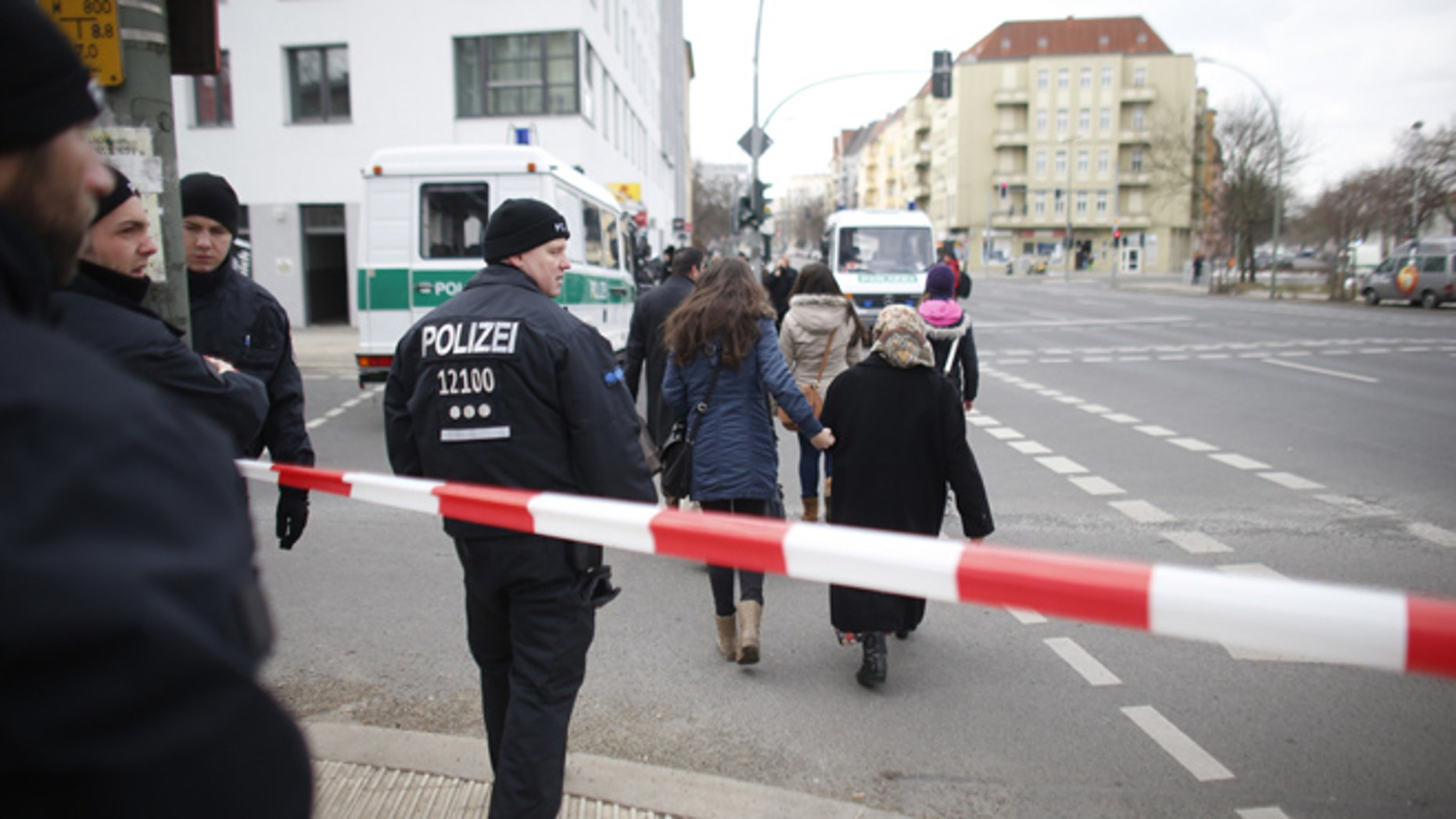 April 3, 2013: Police officers  advise inhabitants to leave an area which had to be evacuated  after a World War II bomb  has been  found  at a building site near  Berlin's main train station  in Berlin. Police spokesman Thomas Neuendorf said the 220-pound bomb was found during construction work on Tuesday evening.