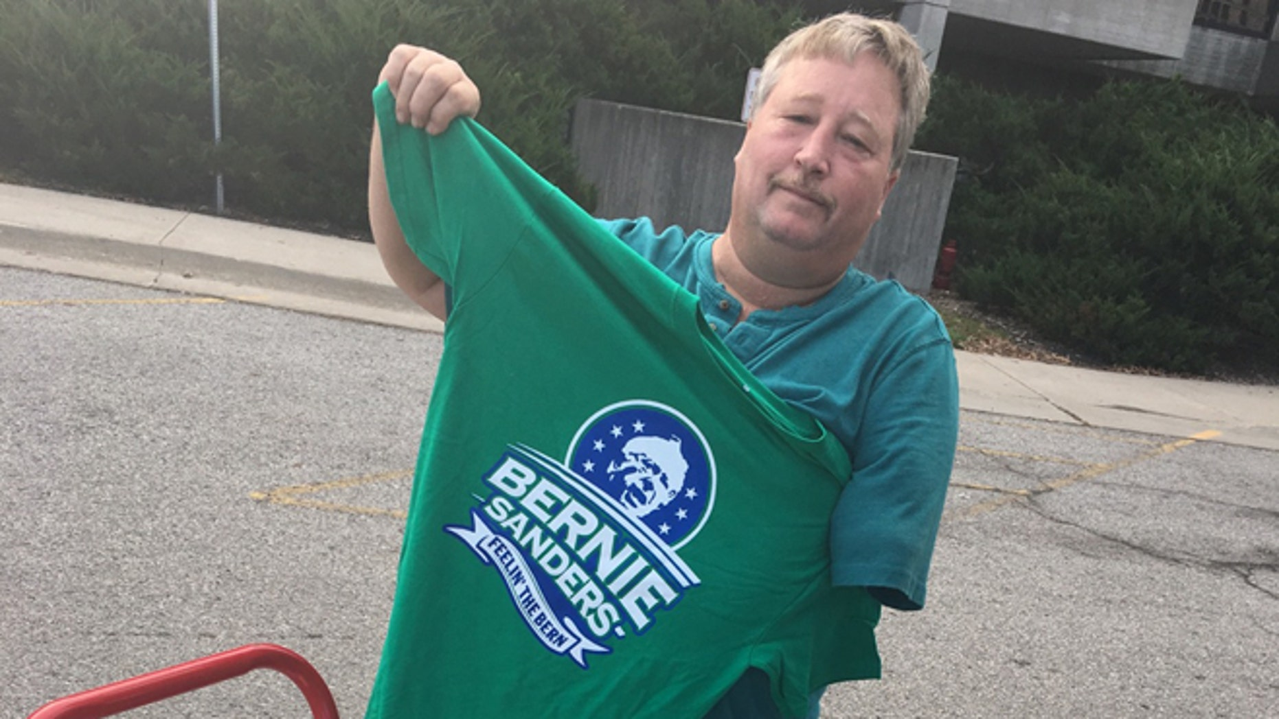 Nov. 5, 2016: Campaign merchandise salesman Daniel Richards outside of a Hillary Clinton rally headlined by Bernie Sanders, Ames, Iowa. Photo by Chris Hibben for Fox News.