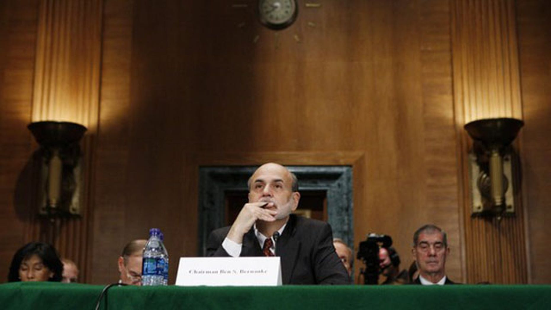 In this Sept. 2, 2010, photo, Federal Reserve Board Chairman Ben Bernanke listens to questioning at a Financial Crisis Inquiry Commission hearing in Washington.
