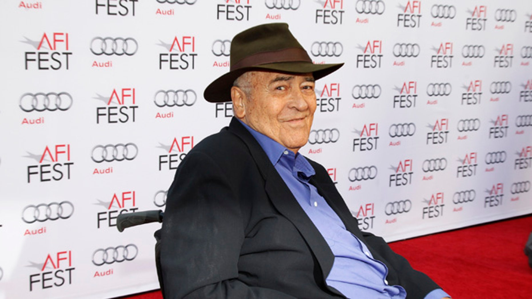 """Italian director Bernardo Bertolucci smiles during an interview as he arrives for a gala screening of his film """"The Last Emperor"""" in 3D at the AFI Fest 2013 in Hollywood, California, November 10, 2013. REUTERS/Fred Prouser (UNITED STATES - Tags: ENTERTAINMENT) - RTX158LK"""
