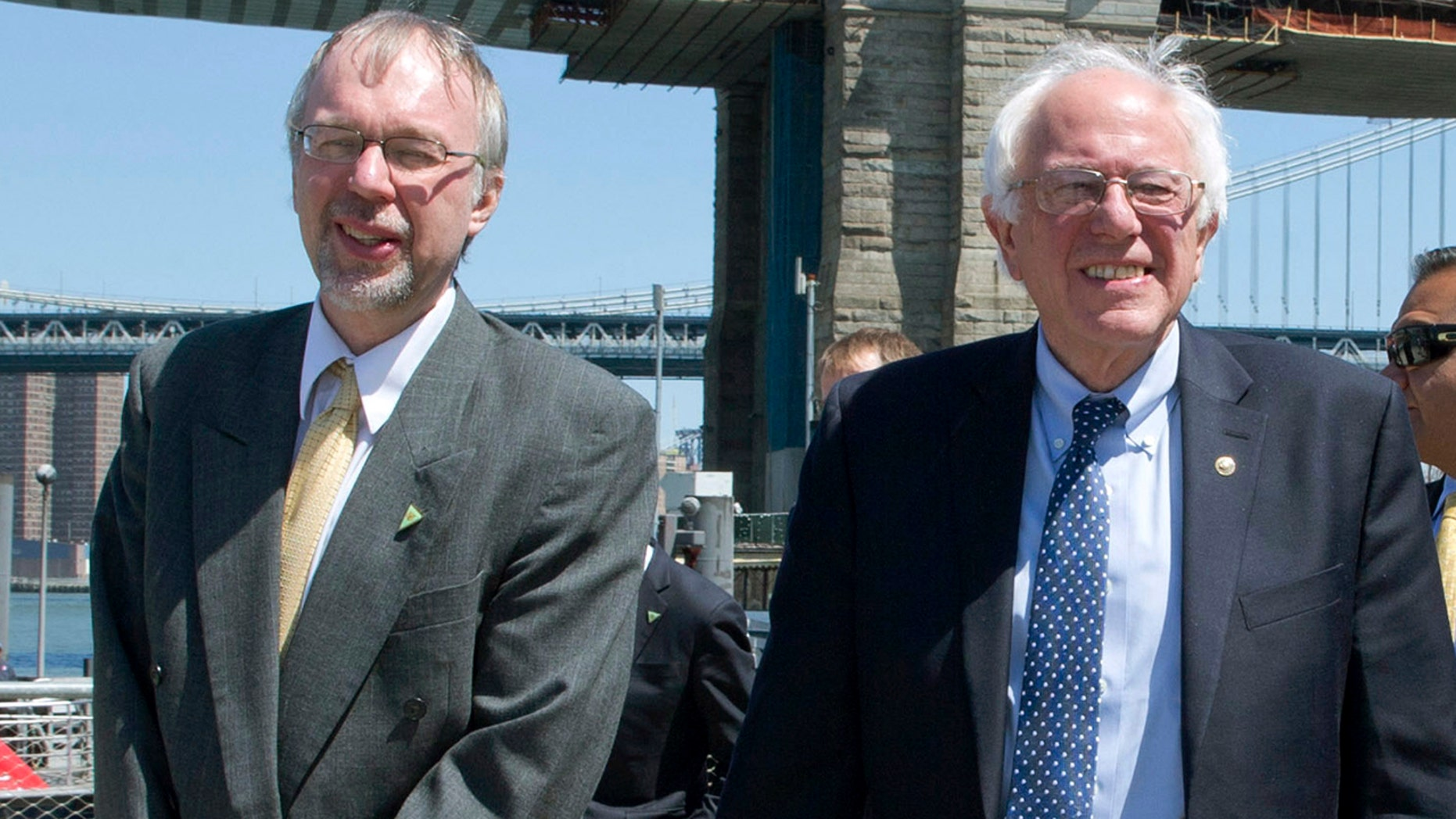 U.S. House candidate Levi Sanders, left, and U.S. Sen. Bernie Sanders, I-Vt., take a walk in Brooklyn Bridge Park in Brooklyn, N.Y., April 7, 2016.