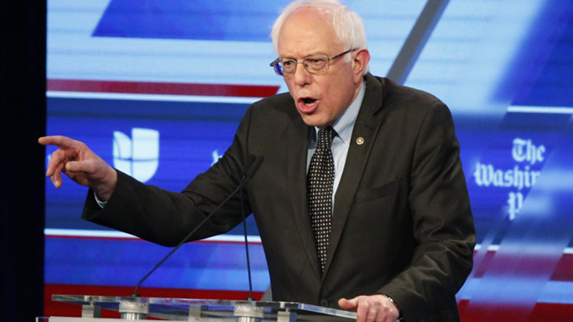 March 9, 2016: Sen. Bernie Sanders speaks at the Univision, Washington Post Democratic presidential debate at Miami-Dade College. His suit, though, was the main event. (AP)