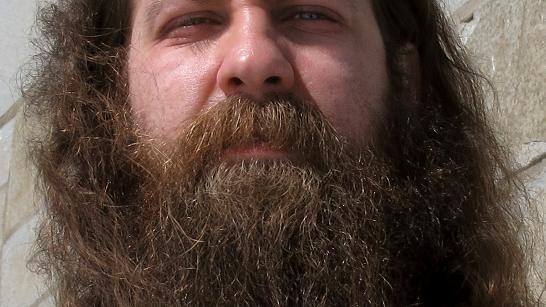 """In this Friday, March 17, 2017 photo Bryan Sturge, of Barre, Vt., shows off his beard, in Montpelier, Vt., that he has entered into the """"Vermont Beardies"""" competition."""