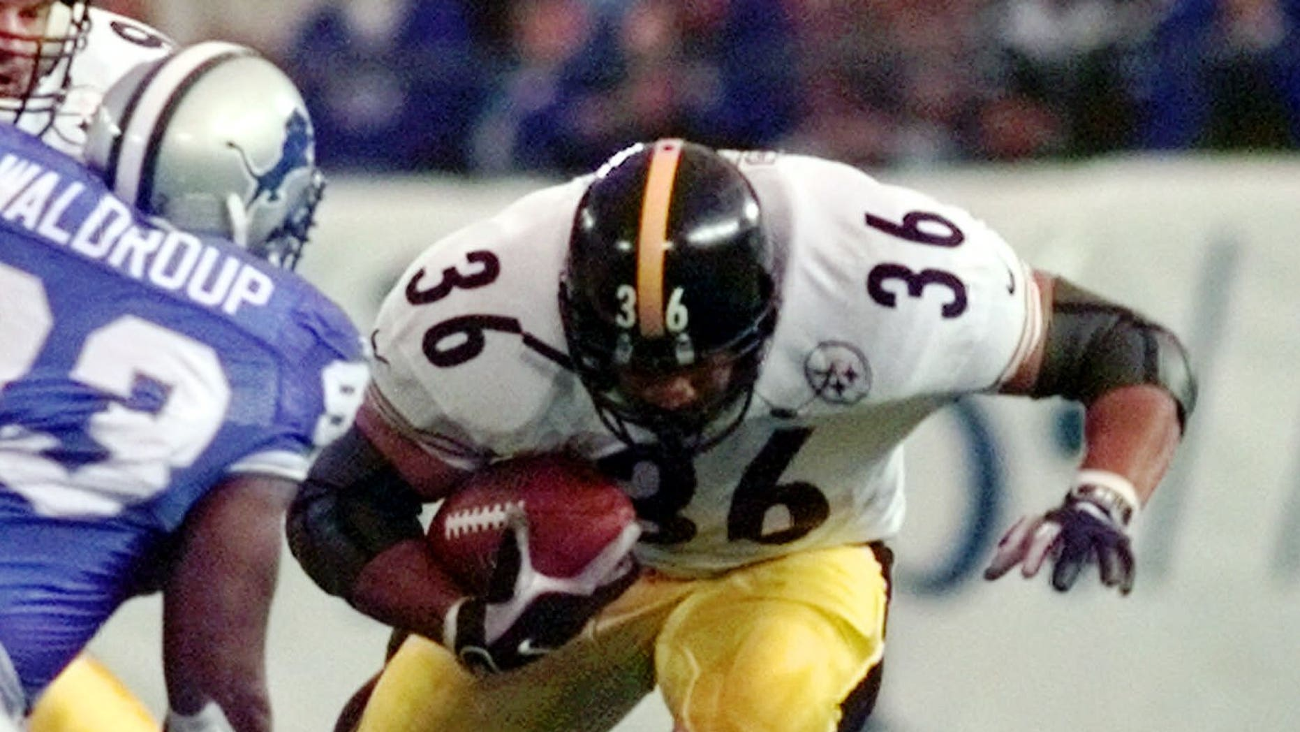 Pittsburgh Steelers running back Jerome Bettis breaks through a hole during the second quarter against the defense of the Detroit Lions in Pontiac, Mich., Thursday, Nov. 26, 1998. (AP Photo/Duane Burleson)