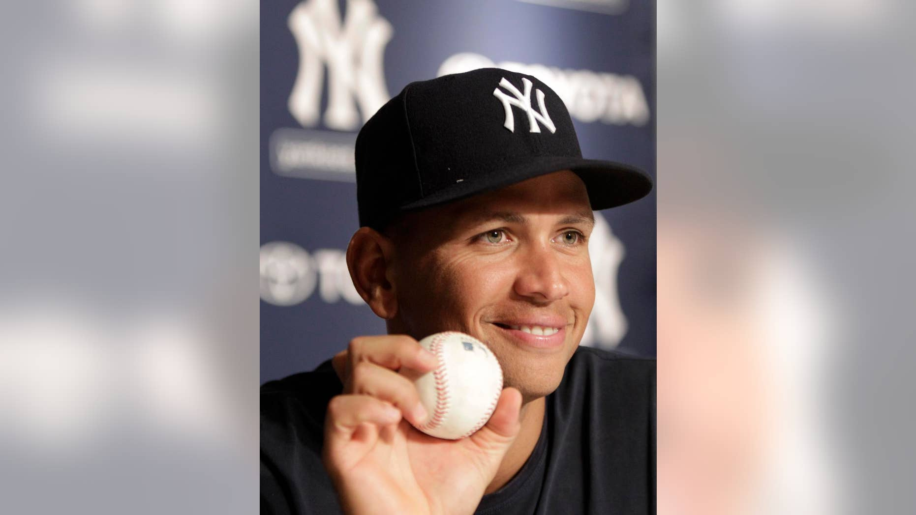 New York Yankees third baseman Alex Rodriguez holds up the baseball he hit for his his 600th career home run ball during a post-game a news conference after the Yankees 5-1 victory over the Toronto Blue Jays in a baseball game at Yankee Stadium on Wednesday, Aug. 4, 2010 in New York. (AP Photo/Kathy Willens)