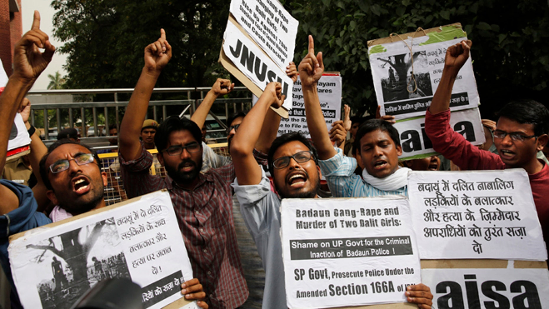 May 30, 2014: Members of Jawaharlal Nehru University Students Union shout slogans during a protest against a gang rape of two teenage girls in Katra village, outside the Uttar Pradesh state house, in New Delhi, India.