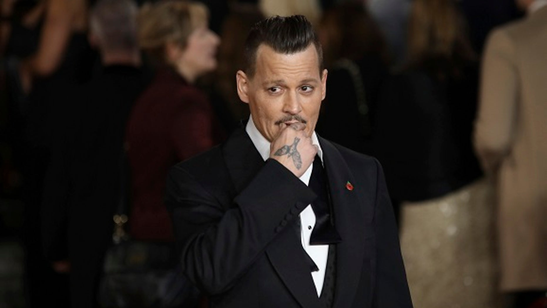 Johnny Depp's former managers want to foreclose the actor's five Los Angeles properties to pay back a $5 million loan they took out for him.