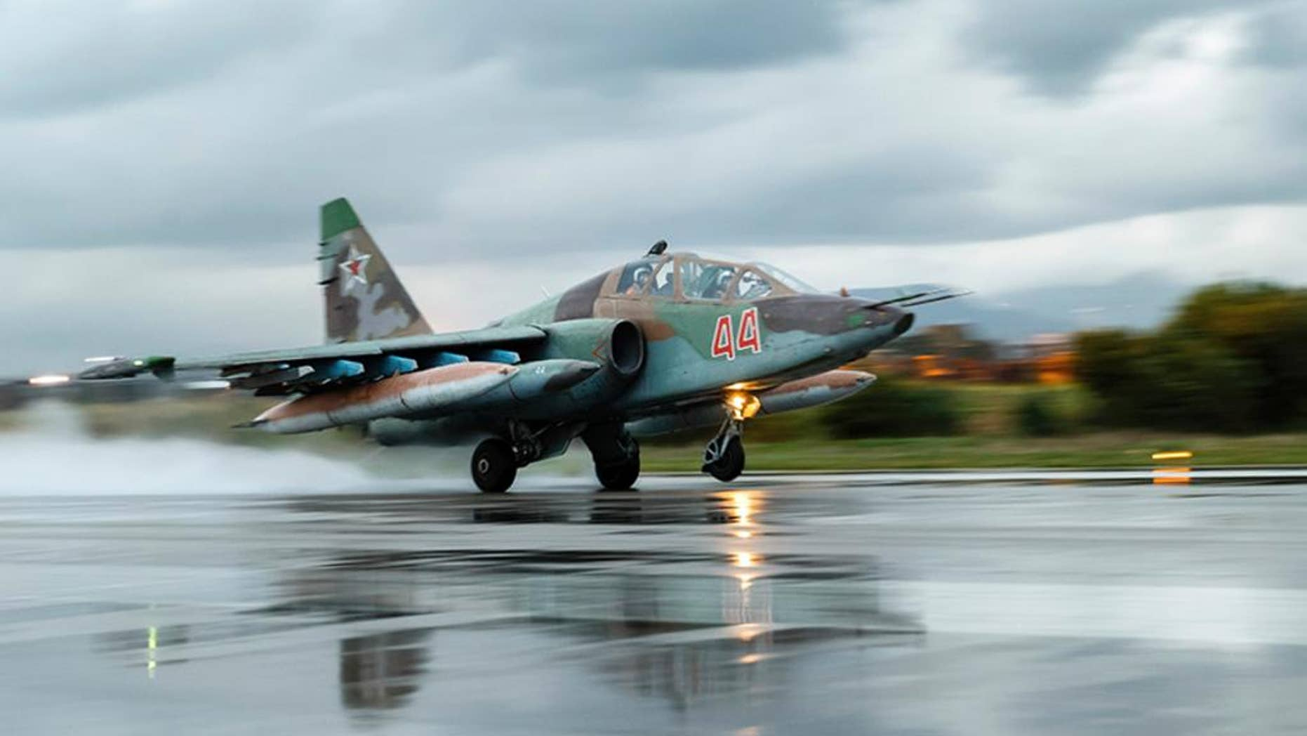 March 16, 2016: A Russian Su-25 ground attack jet takes off at Hemeimeem Air Base in Syria.