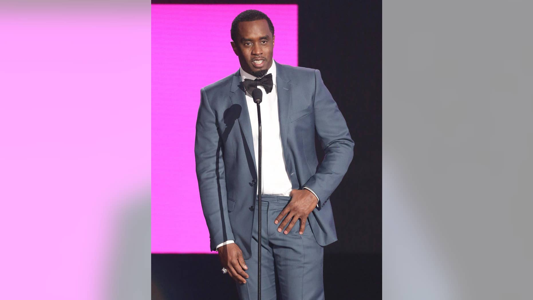 """FILE - In this Nov. 22, 2015, file photo, Sean """"Diddy"""" Combs presents the award for best collaboration of the year at the American Music Awards in Los Angeles. Combs, the founder of Capital Preparatory Harlem Charter School, announced Monday, March 28, 2016, that the school will open in the fall of 2016. (Photo by Matt Sayles/Invision/AP, File)"""
