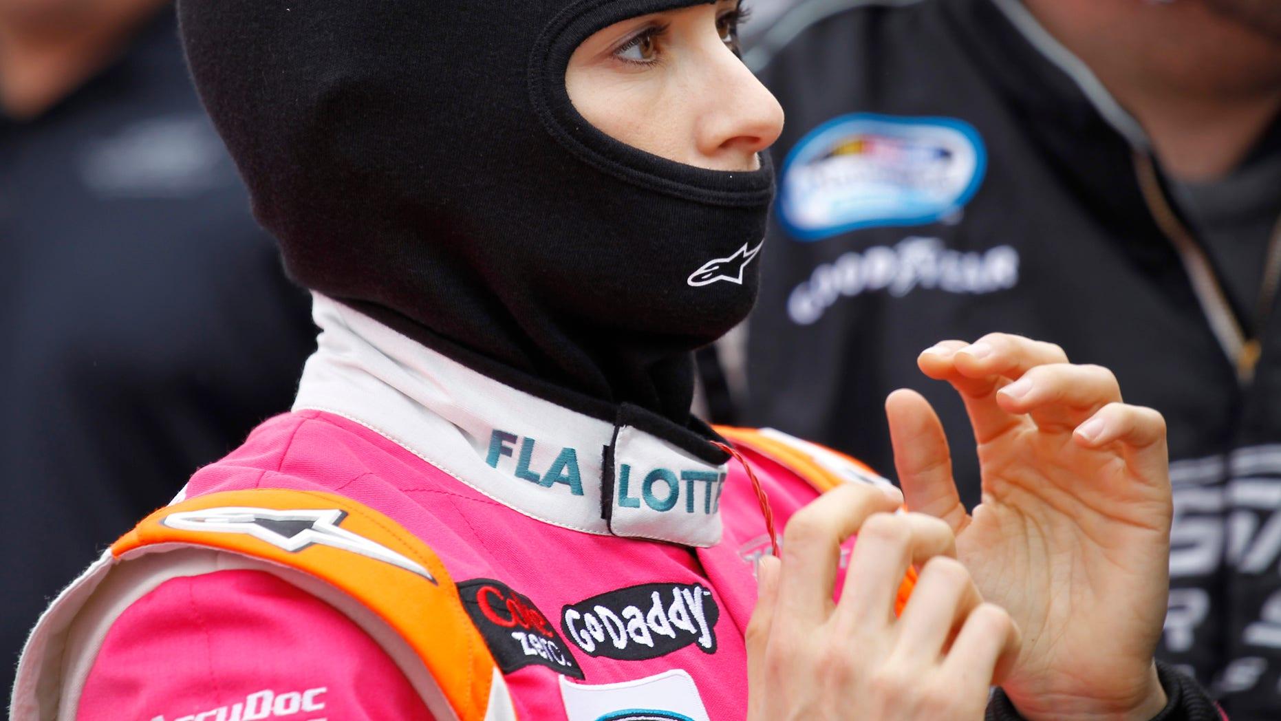 Danica Patrick prepares for the NASCAR Nationwide series auto race at Daytona International Speedway in Daytona Beach, Fla., Saturday, Feb. 22, 2014. (AP Photo/Terry Renna)